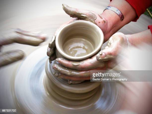 a trainer guides producing earthenware - pakistani culture stock photos and pictures