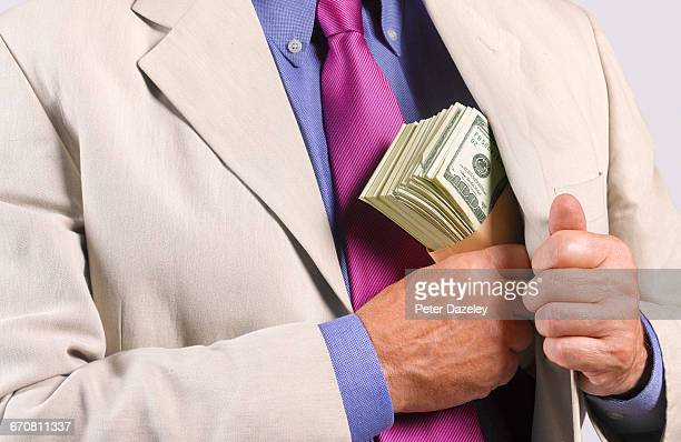 proceeds of crime - falsenews stock pictures, royalty-free photos & images