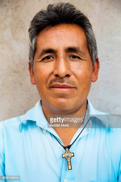 a man with a crucifix around his neck - pendant stock pictures, royalty-free photos & images