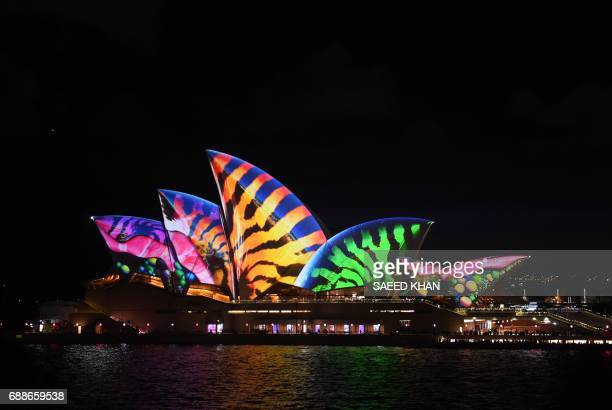 A light show called 'Vivid' changes the appearance of the Sydney Opera House in Sydney on May 26 2017 'Vivid' is a major outdoor cultural event...