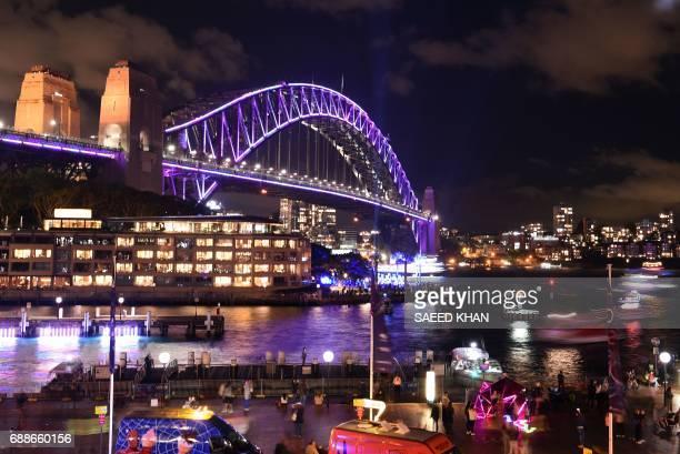 Australia's iconic landmark Harbour Bridge is seen illuminated on the first day of the light festival 'Vivid Sydney' on May 26 2017 in Sydney 'Vivid'...