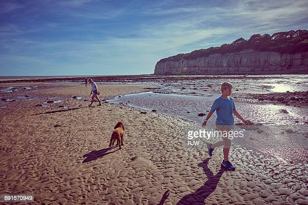 family on beach - kent county stock pictures, royalty-free photos & images