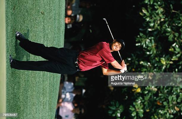 TIGER WOODS HITS A SHOT DURING THE 2001 MASTERS TOURNAMENT.