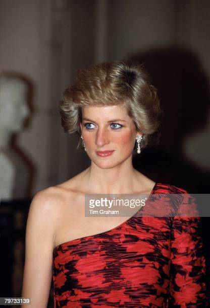 DIANA, PRINCESS OF WALES IN PARIS IN A RED AND BLACK ONE-SHOULDERED EVENING DRESS DESIGNED BY FASHION DESIGNER CATHERINE WALKER AT A DINNER GIVEN BY...