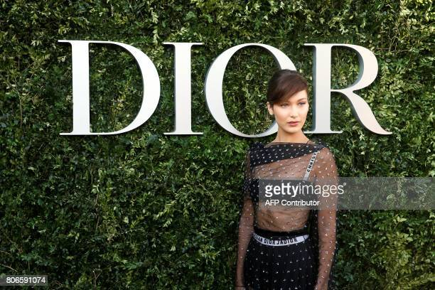 US model Bella Hadid poses as she arrives for the opening of the Dior exhibition that celebrates the seventieth anniversary of the Christian Dior...
