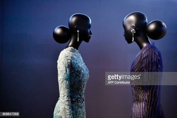 Dresses by Italian fashion designer Gianfranco Ferre are pictured during the Dior exhibition that celebrates the seventieth anniversary of the...