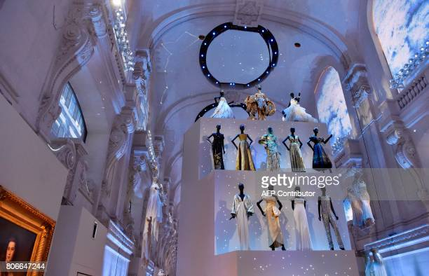 Dresses are pictured during the Dior exhibition that celebrates the seventieth anniversary of the Christian Dior fashion house on July 3 2017 in...