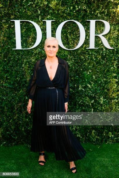 Italian fashion designer Maria Grazia Chiuri poses as she arrives for the opening of the Dior exhibition that celebrates the seventieth anniversary...