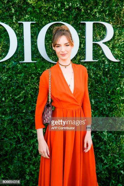 French actress Louise Bourgoin poses as she arrives for the opening of the Dior exhibition that celebrates the seventieth anniversary of the...