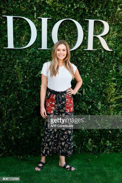 US actress Elizabeth Olsen poses as she arrives for the opening of the Dior exhibition that celebrates the seventieth anniversary of the Christian...