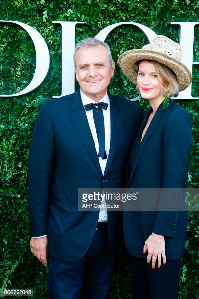 French fashion designer JeanCharles de Castelbajac and Pauline de Drouas pose as they arrive for the Dior exhibition that celebrates the seventieth...