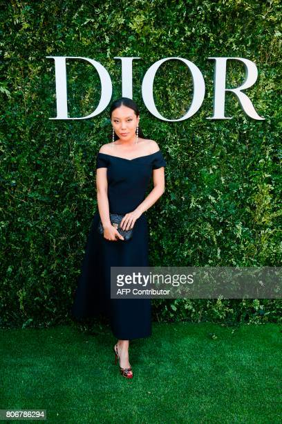 Chinese jewellery designer Bao Bao Wan poses as she arrives for the opening of the Dior exhibition that celebrates the seventieth anniversary of the...