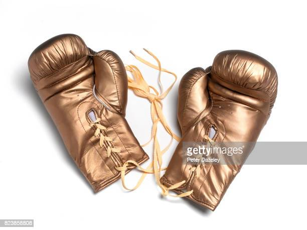 professional pair of gold boxing gloves - boxing gloves stock pictures, royalty-free photos & images