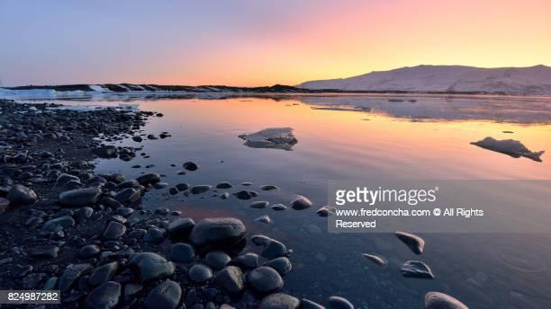 SUNSET AT JOKULSARLON GLACIER LAGOON IN ICELAND
