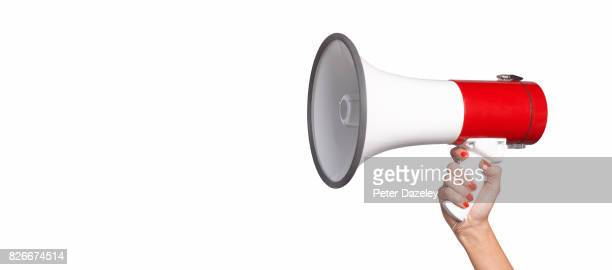 woman using megaphone with copy space - urgency stock pictures, royalty-free photos & images
