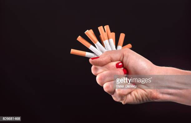 new years resolution quitting smoking - red nail polish stock pictures, royalty-free photos & images