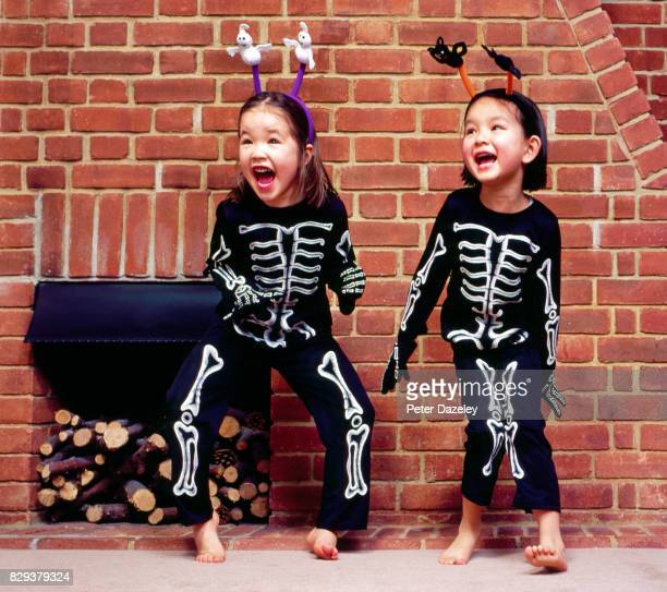 halloween girls in skeleton outfits - naughty halloween stock photos and pictures