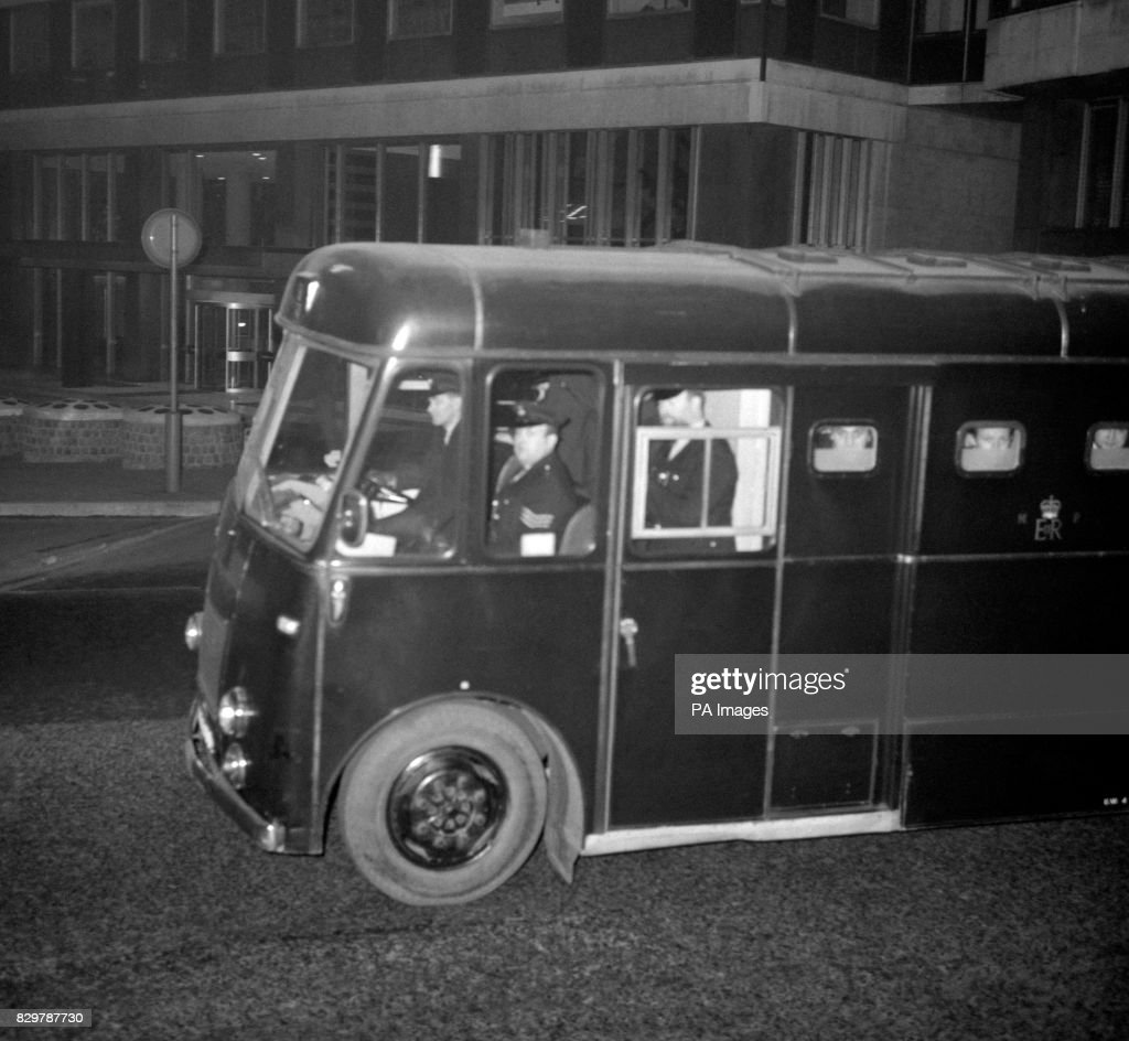 FACES AT THE WINDOW OF A BLACK MARIA AS IT HEADS TOWARDS BRIXTON PRISON AFTER THE CONCLUSION OF PROCEEDINGS AT THE OLD BAILEY TRIAL OF THE KRAY TWINS AND OTHERS. THE JURY RETURNED THEIR VERDICT AFTER A RETIREMENT OF 6 HRS AND 55 MINS. SENTENCE WILL BE PASSED TOMORROW.