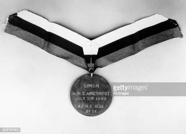 THE MEDAL AWARDED TO SIMON THE SHIP'S CAT ABOARD HMS AMETHYST, A DICKIN MEDAL, THE ANIMALS VC. THE HISTORIC AWARD IS EXPECTED TO FETCH UP TO 3,000...