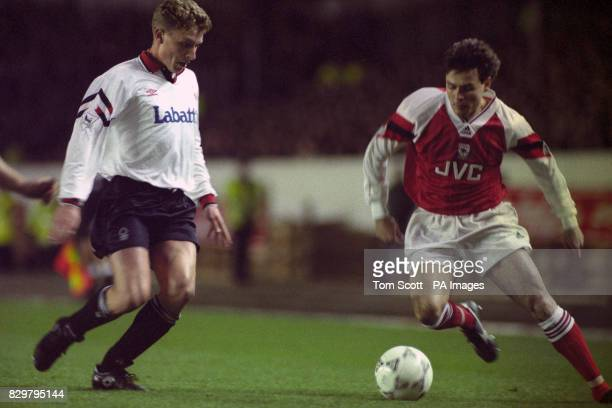 S ANDERS LIMPAR [RIGHT] IS CHALLENGED FOR THE BALL BY NOTTINGHAM FOREST'S SCOTT GEMMILL DURING THE COCA COLA 5TH ROUND MATCH AT HIGHBURY