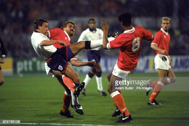 S PAUL MERSON IS UPENDED BY FRANK RIJKAARD OF HOLLAND IN THE WORLD CUP QUALIFYING MATCH IN ROTTERDAM