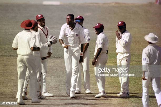 THE WEST INDIANS CELEBRATE THE WICKET OF ENGLAND'S ROBIN SMITH DURING THE 3RD 0NE-DAY INTERNATIONAL.
