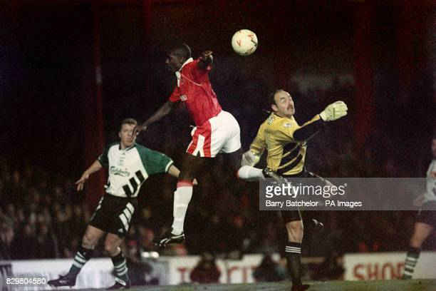 S WAYNE ALLISON LIVERPOOL GOALKEEPER BRUCE GROBBELAAR BOTH MISS OUT ON A HIGH BALL DURING THE FA CUP 3RD ROUND REPLAY MATCH
