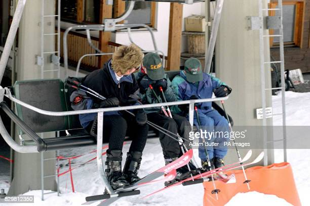 THE PRINCESS OF WALES AND HER SONS PRINCE WILLIAM AND PRINCE HARRY [R] HIDE FROM PHOTOGRAPHERS AS THEY TAKE THE FIRST CHAIR LIFT ON THE SECOND DAY OF...