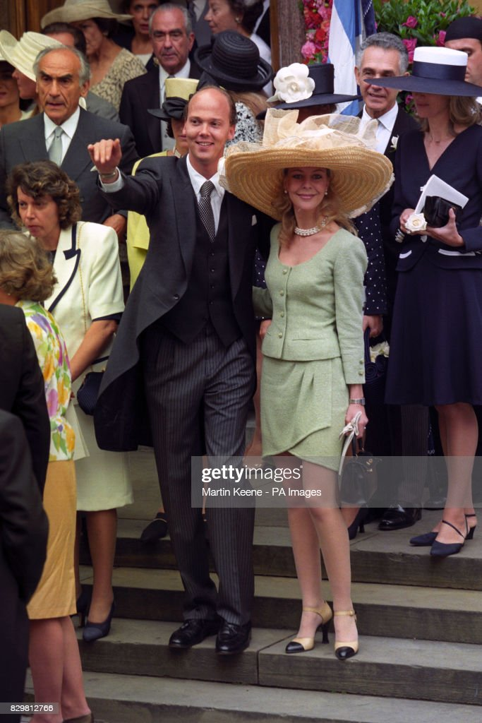 PRINCE SERGE OF YUGOSLAVIA AND VANESSA VON ZITZWITZ LEAVE ST SOPHIA'S CATHDERAL FOLLOWING THE WEDDING OF MARIE-CHANTAL MILLER TO THE EXILED CROWN PRINCE PAVLOS OF GREECE