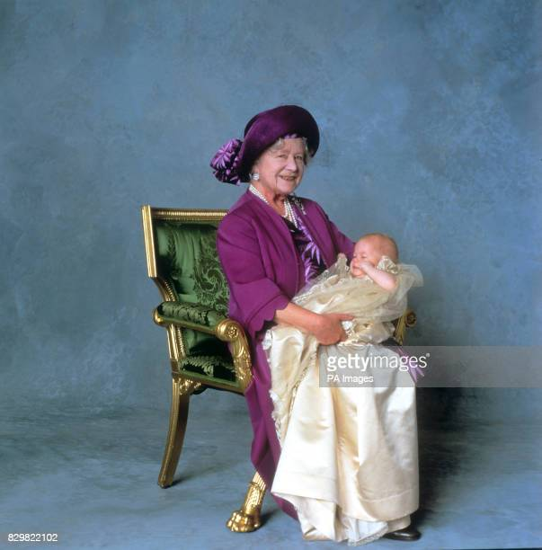 THREE-MONTH-OLD PRINCE HENRY OF WALES SEEN WITH HIS GREAT-GRANDMOTHER QUEEN ELIZABETH THE QUEEN MOTHER ON HIS CHRISTENING DAY.