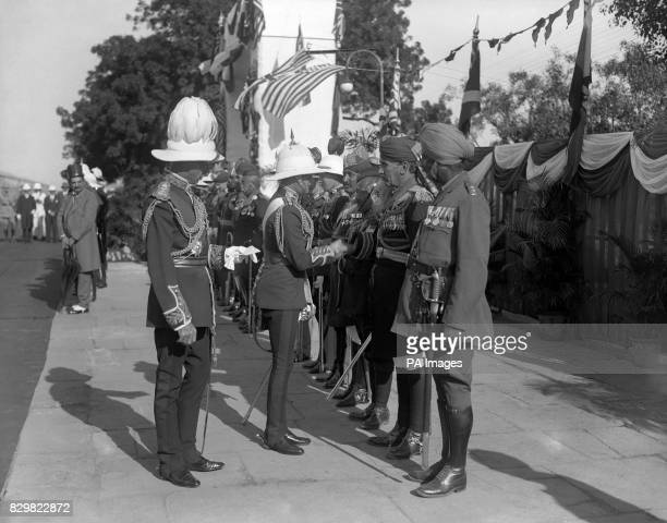 WALES' TOUR OF JAPAN AND THE FAR EAST DELHI ON ARRIVAL AT SELIMGURGH STATION OFFICERS OF THE INDIAN ARMY HEADQUARTERS STAFF ARE PRESENTED TO HRH BY...
