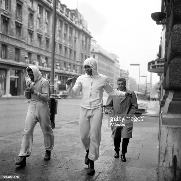 DURING AN EARLY MORNING TRAINING SESSION JOGGING ALONG LOWER REGENT STREET LONDON TO HIS WORKOUT IN HYDE PARK BEFORE HIS BRITISH HEAVYWEIGHT CLASH...
