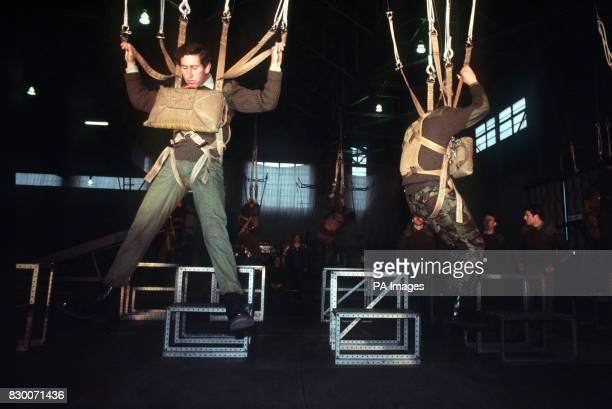 AND HIS 18 YEAR OLD BROTHER PRINCE ANDREW HANG IN PARACHUTE HARNESSES AFTER JUMPING FROM AIRCRAFT MOCKUPS AT RAF BRIZE NOTON WHERE THEY ARE BOTH...
