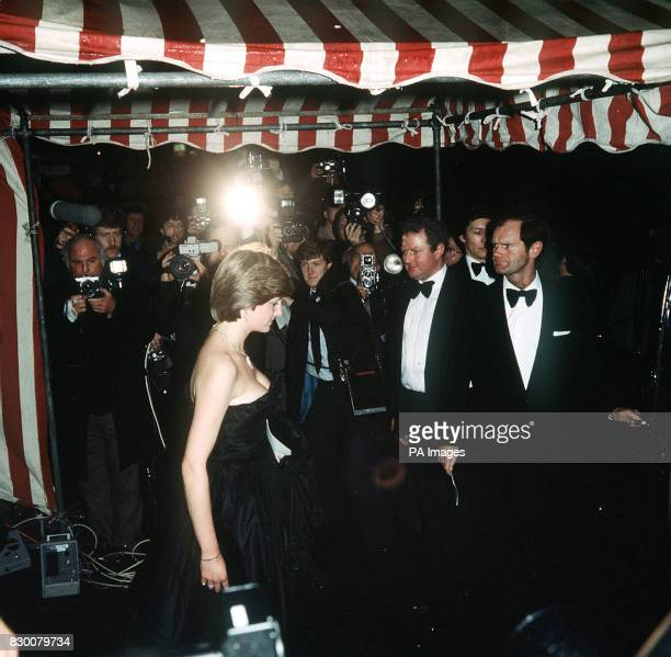 WEARING A LOWCUT EVENING DRESS WITH THE PRINCE OF WALES ARRIVING AT THE GOLDSMITH'S HALL IN LONDON AS GUESTS AT AN ENTERTAINMENT IN AID OF THE ROYAL...
