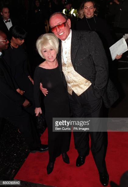 ACTORS MIKE REID AND BARBARA WINDSOR, WHO STAR AS EASTENDERS COUPLE FRANK BUTCHER AND PEGGY MITCHELL, ARRIVE AT THE ROYAL ALBERT HALL IN LONDON FOR...