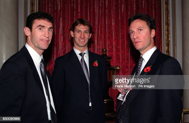 PA NEWS 29/10/98 SIMON LEWIS , COMMUNICATIONS SECRETARY TO THE QUEEN, WITH ARSENAL AND ENGLAND FOOTBALLERS MARTIN KEOWN AND TONY ADAMS AT A RECEPTION...