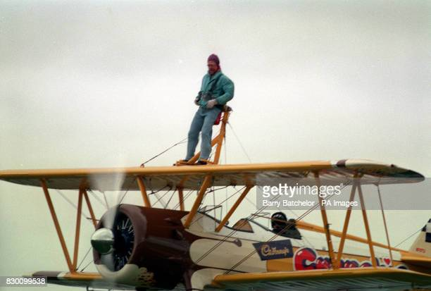 PA NEWS PHOTO 25/9/95 BERGERAC STAR JOHN NETTLES TAKES TO THE SKIES AFTER BEING STRAPPED TO A STEARMAN AIRCRAFT FOR HIS FIRST WING WALK AT EXETER...