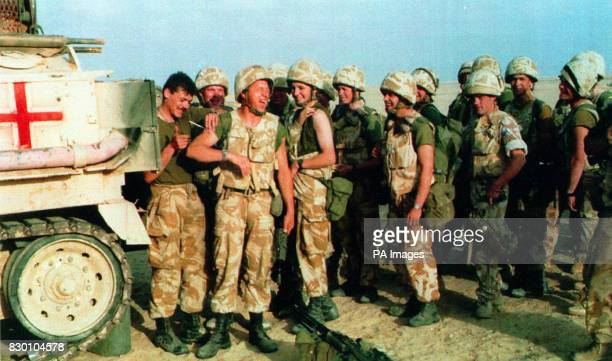 FROM 'B' COMPANY OF THE ROYAL SCOTS BASED NEAR THE SAUDI ARABIAN FRONTLINE LINE UP TO RECEIVE THEIR INJECTIONS AGAINST POSSIBLE CHEMICAL ATTACKS