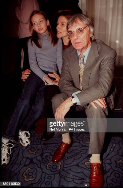 PA NEWS PHOTO 12/12/98 BERNIE ECCLESTONE, BOSS OF FORMULA 1 MOTOR RACING, WITH HIS WIFE SLAVICA AND DAUGHTER PETRA AT A CHILDREN'S CHRISTMAS PARTY,...