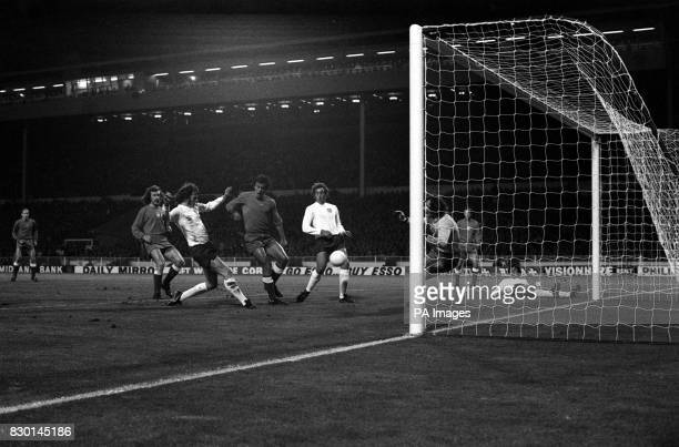 PA NEWS PHOTO 17/10/73 A LIBRARY FILE PICTURE OF ENGLAND'S MIKE CHANNON HITS A SHOT GOALWARDS, ONLY TO SEE IT HIT THE POST DURING THE THE WORLD CUP...