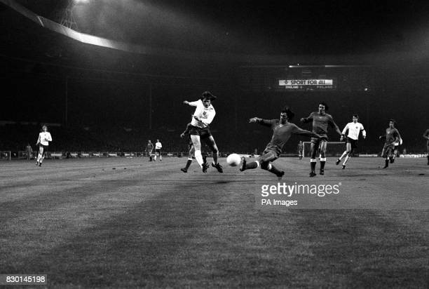 PA NEWS PHOTO 17/10/73 A LIBRARY FILE PICTURE OF POLAND'S BULZACKI PREVENTS A SHOT FROM ENGLAND'S MIKE CHANNON DURING THE WORLD CUP QUALIFYING MATCH...