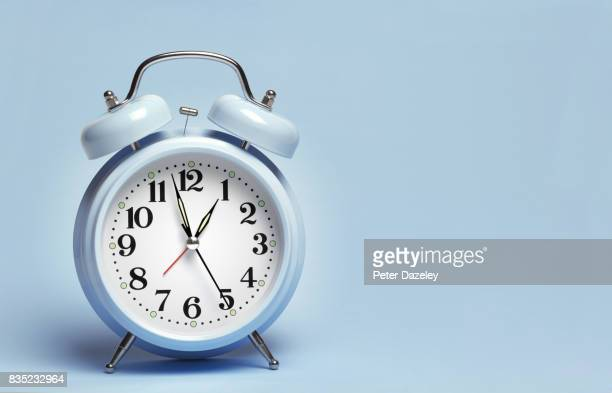 blue alarm clock - clock stock pictures, royalty-free photos & images