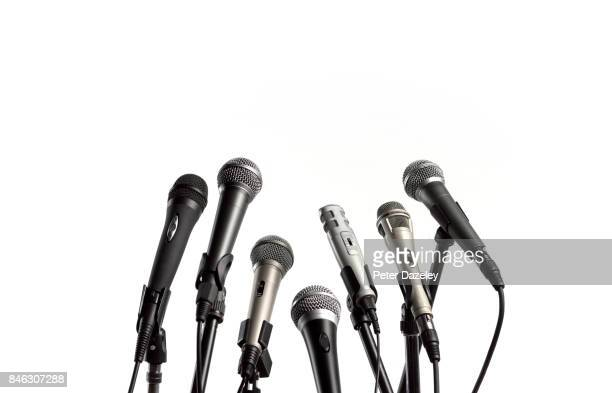 close up of press conference microphones - voice stock pictures, royalty-free photos & images