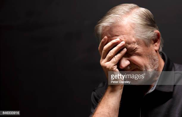 senior man with headache amnesia - touching stock pictures, royalty-free photos & images