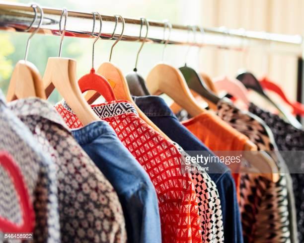 WOMANS CLOTHS ON A RAIL