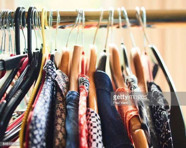 ROW OF WOMANS CLOTHS ON A RAIL