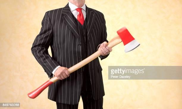 BUSINESSMAN ACCOUNTANT CUTTING JOBS