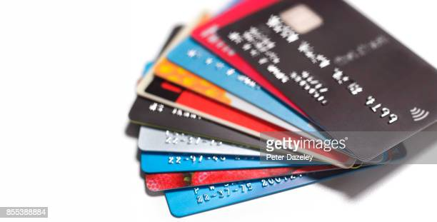 pile of credit cards - charging stock pictures, royalty-free photos & images