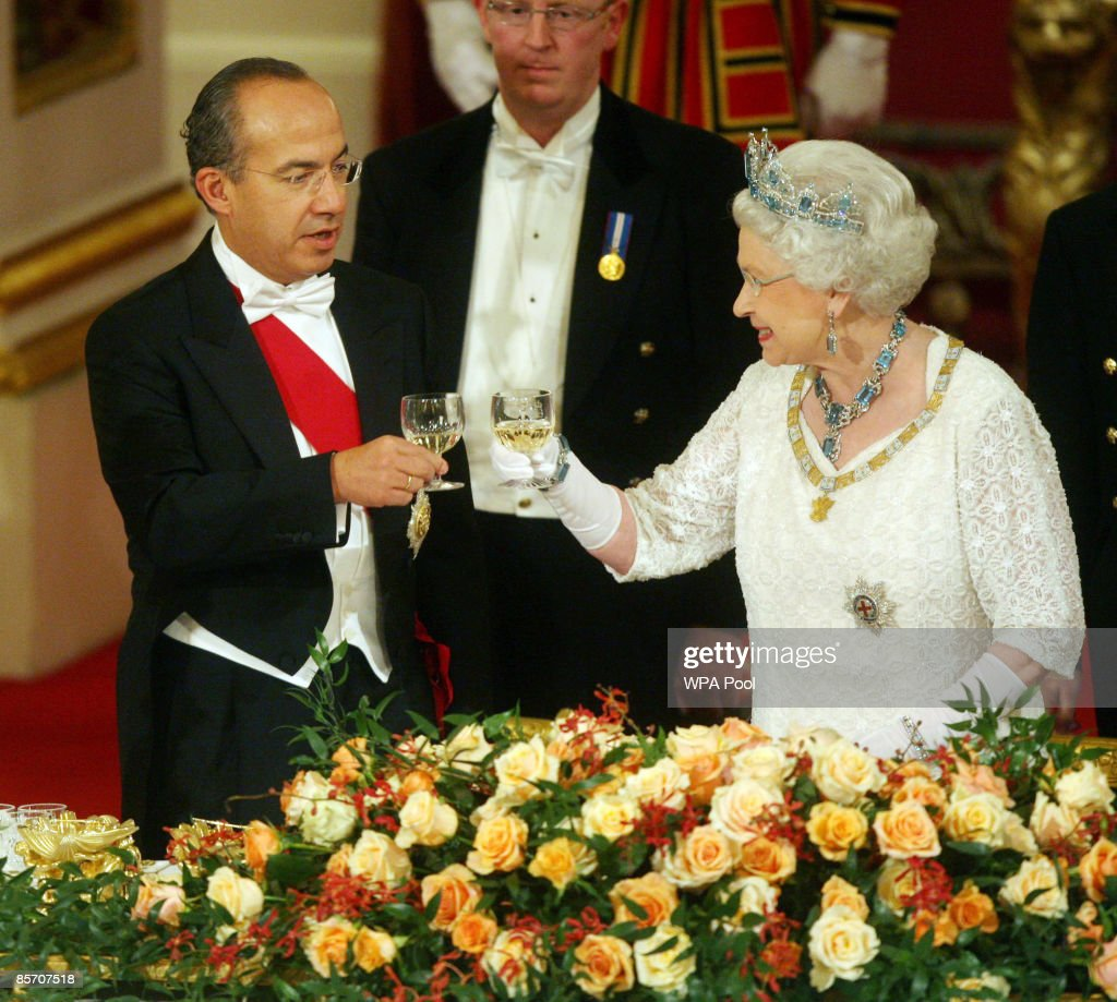 Queen Elizabeth II and Mexico's President Felipe Calderon (L) toast their glasses during a state banquet hosted by the Queen in honour of the visiting president and first lady, inside the Ballroom at Buckingham Palaceon March 30, 2009 in London, England. President of the United Mexican States Felipe Calderon and his wife Margarita Zavala de Calderon are on a four-day state visit to the United Kingdom from March 30 - April 2.