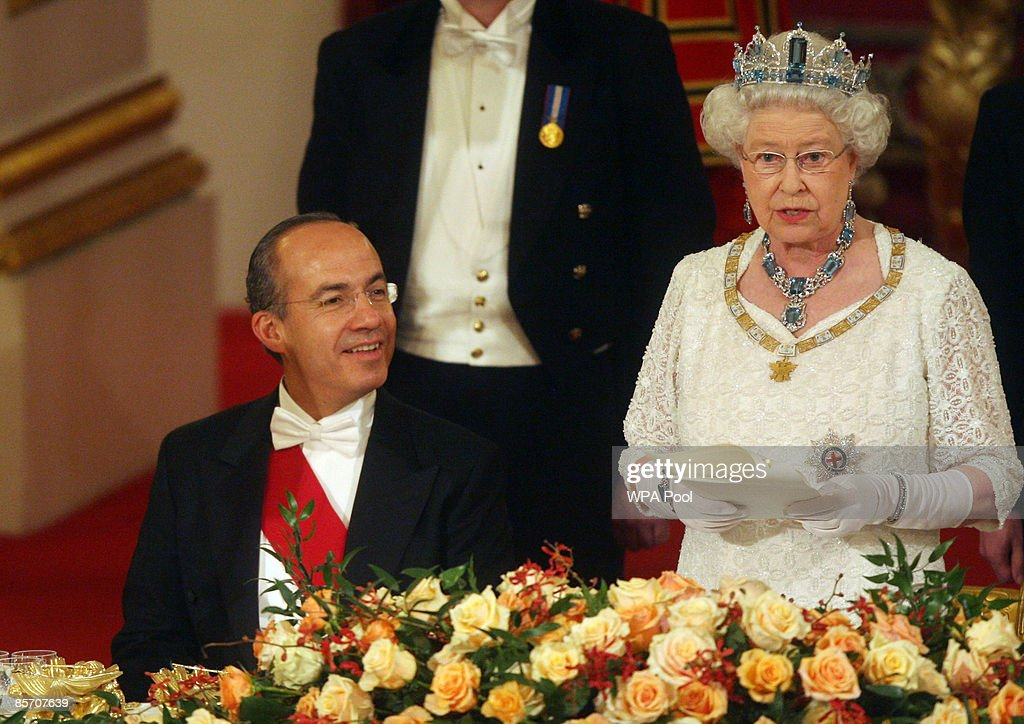 Queen Elizabeth II speaks Mexico's President Felipe Calderon (L) during a state banquet hosted by the Queen in honour of the visiting president and first lady, inside the Ballroom at Buckingham Palace on March 30, 2009 in London, England. President of the United Mexican States Felipe Calderon and his wife Margarita Zavala de Calderon are on a four-day state visit to the United Kingdom from March 30 - April 2.